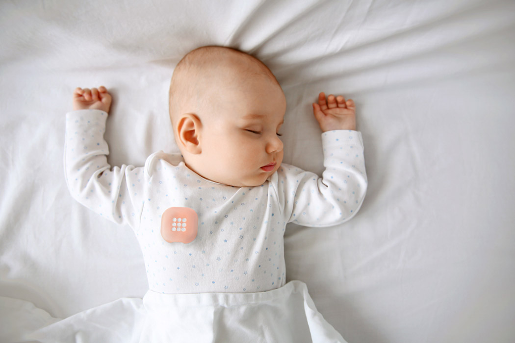 Beautiful sleeping baby in bed